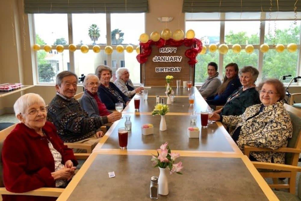 Residents enjoying their monthly birthday lunch at Merrill Gardens at Rockridge in Oakland, California