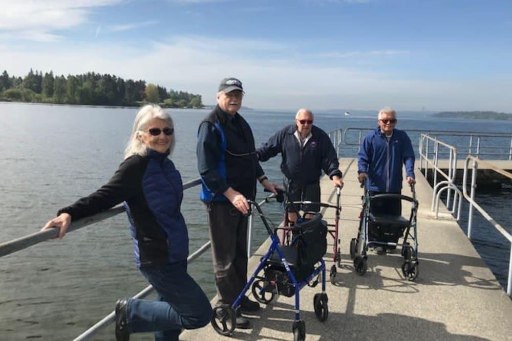 Residents taking a walk near Merrill Gardens at Kirkland in Kirkland, Washington.