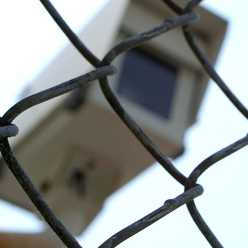 Security camera behind a chain link fence at Red Dot Storage in Terre Haute, Indiana