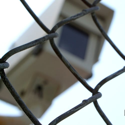 Security camera behind a chain link fence at Red Dot Storage in Yorkville, Illinois