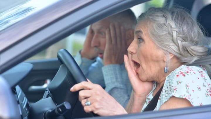 Senior residents in a car at {{location_name}} in {{location_city}}, {{location_state_name}}