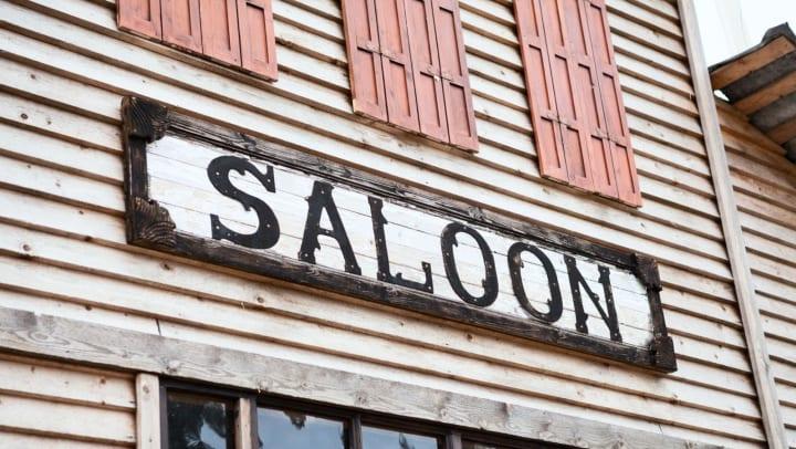 Saloon sign on a building facade
