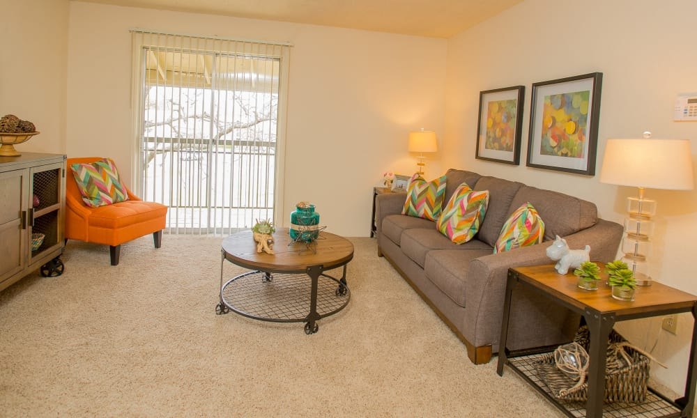 Living room with patio access at Country Hollow in Tulsa, Oklahoma
