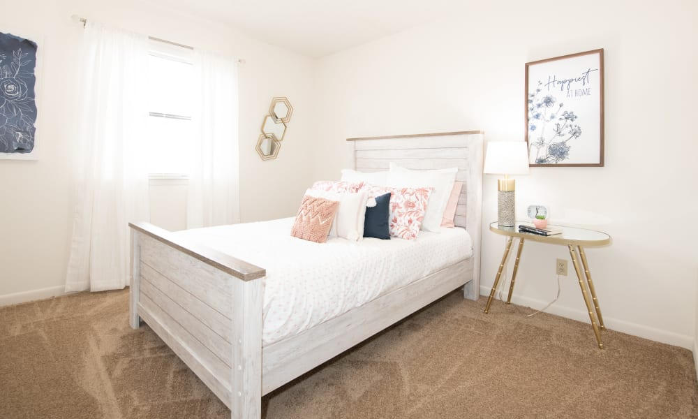 A large bed in an apartment at The Mark Apartments in Ridgeland, MS