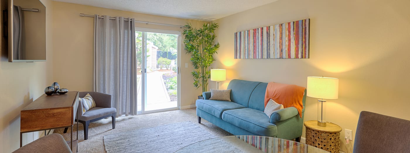 Spacious and well-decorated living area in model home at The Boulevard at South Station Apartment Homes in Tukwila, WA