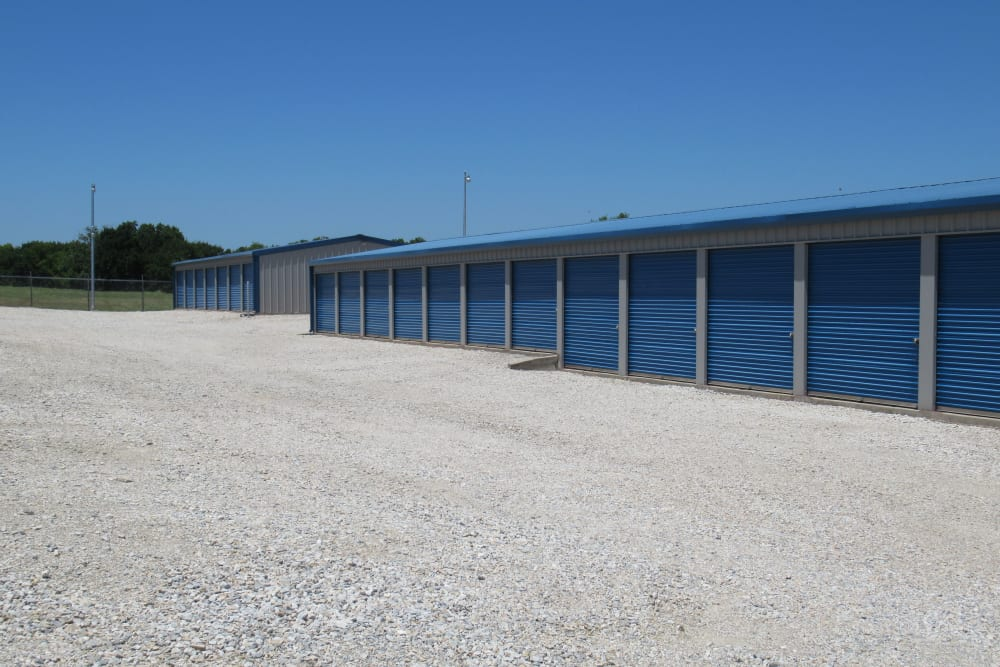 Row of outdoor storage units with roll up doors at Springtown Self Storage