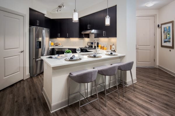 Gourmet kitchen with quartz countertops in a model home at The Core Scottsdale in Scottsdale, Arizona