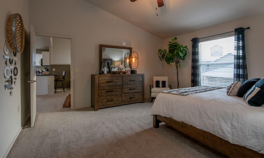 Master bedroom at Stonehorse Crossing Apartments in Oklahoma City, Oklahoma
