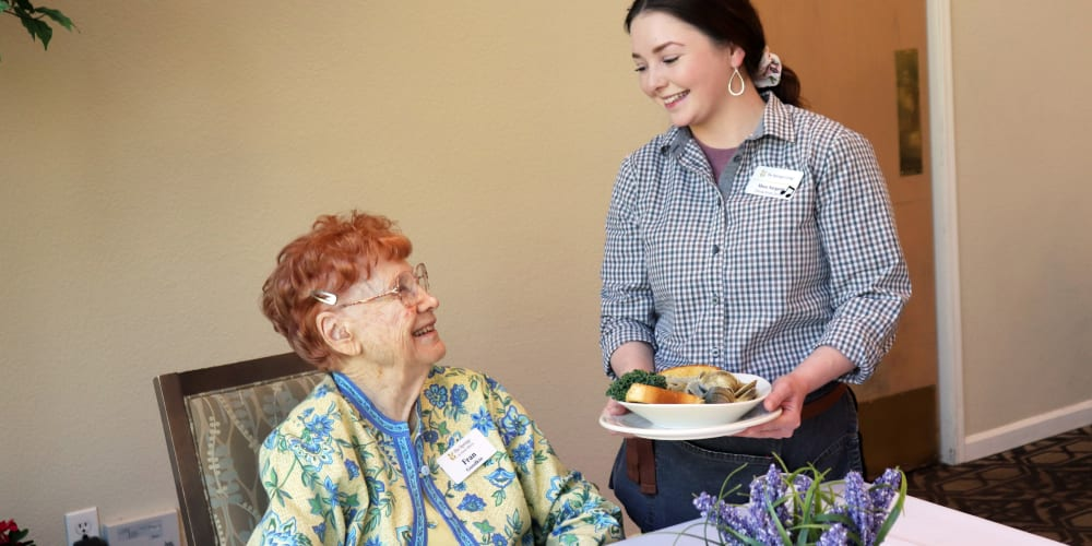 Resident and caretaker at the dining lounge at The Springs at Anna Maria in Medford, Oregon
