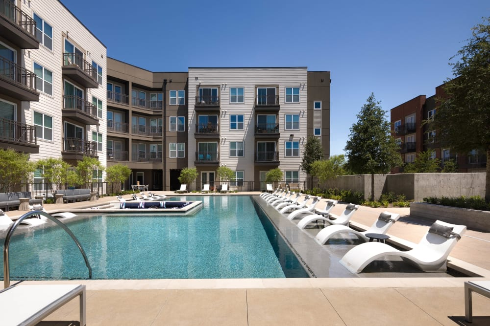 Gorgeous resort-style swimming pool at Olympus on Main in Carrollton, Texas