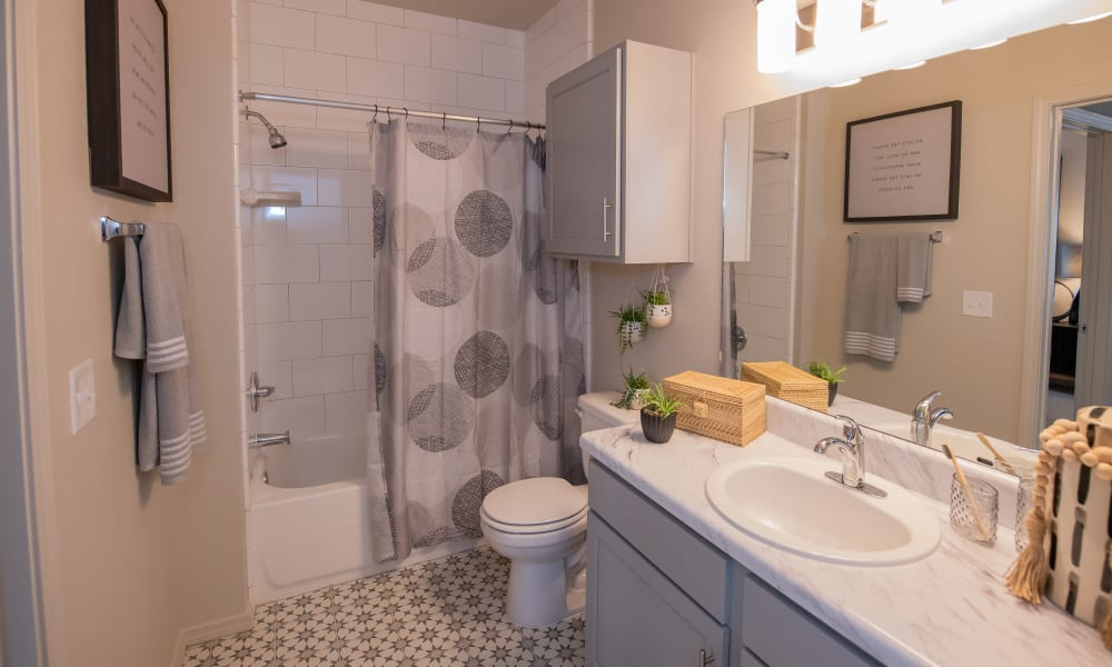 Large bathroom at Bend at New Road Apartments in Waco, Texas