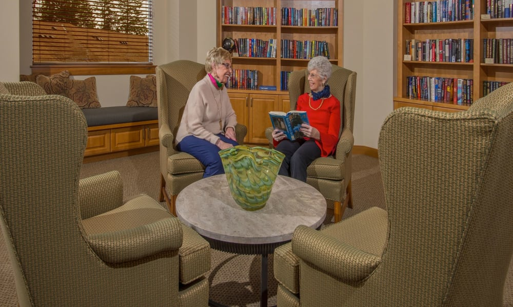 Comfortable seating in the library at Quail Park at Browns Point in Tacoma, Washington