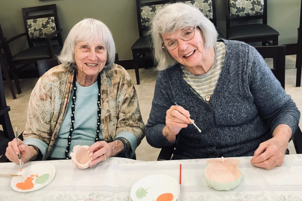 Two residents enjoying time together at our senior living community