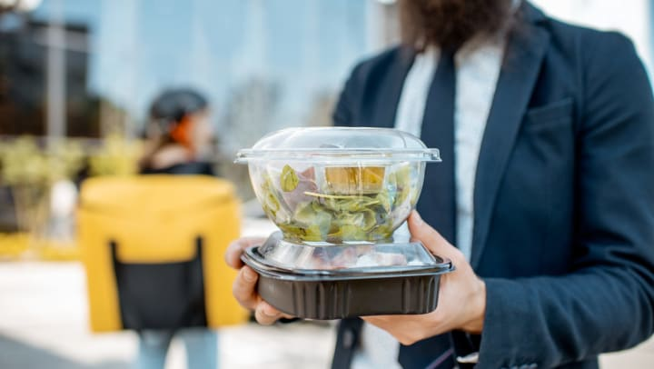 Man carrying takeout lunch back to his office