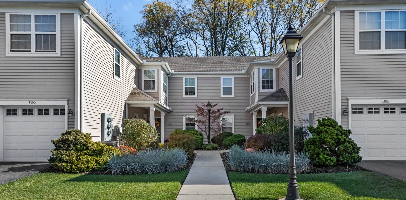 Professionally maintained landscaping and clean sidewalks outside resident buildings at Hanover Glen in Bethlehem, Pennsylvania