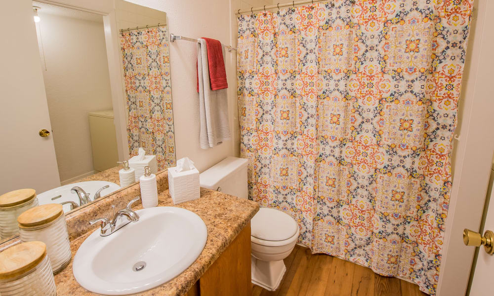 Bathroom with shower and tub combo at Windsail Apartments in Tulsa, Oklahoma