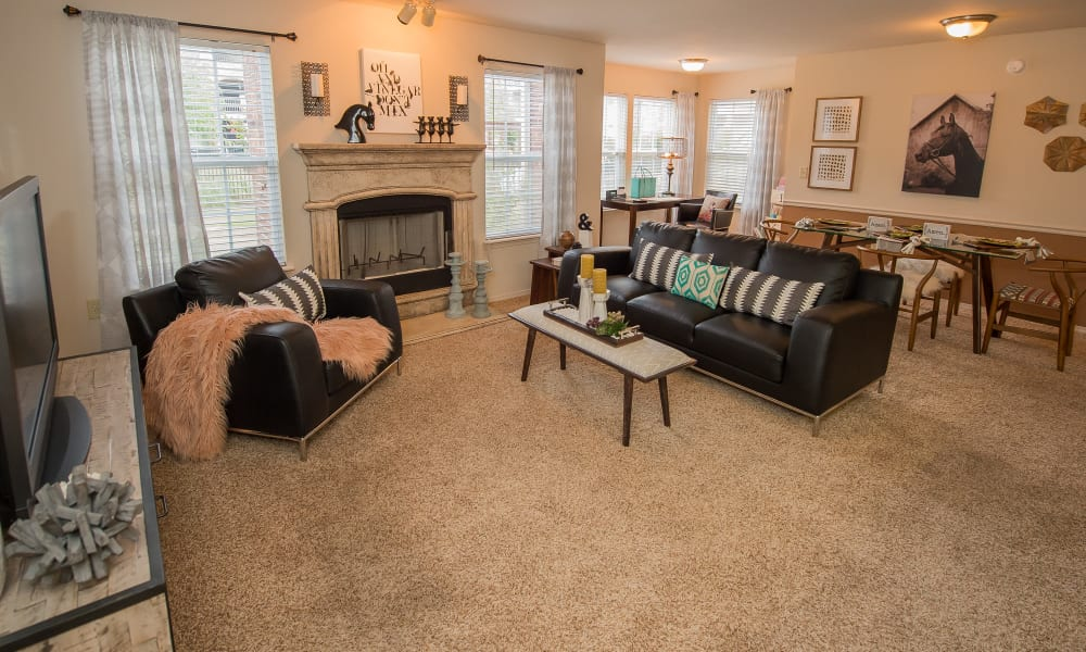 Carpeted living room with a fireplace at The Park on Westpointe in Yukon, Oklahoma