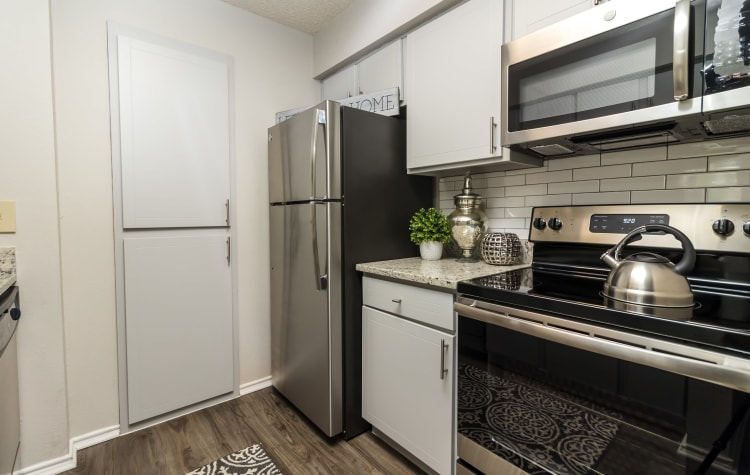 Kitchen with plenty of storage space at The Logan in Bedford, Texas