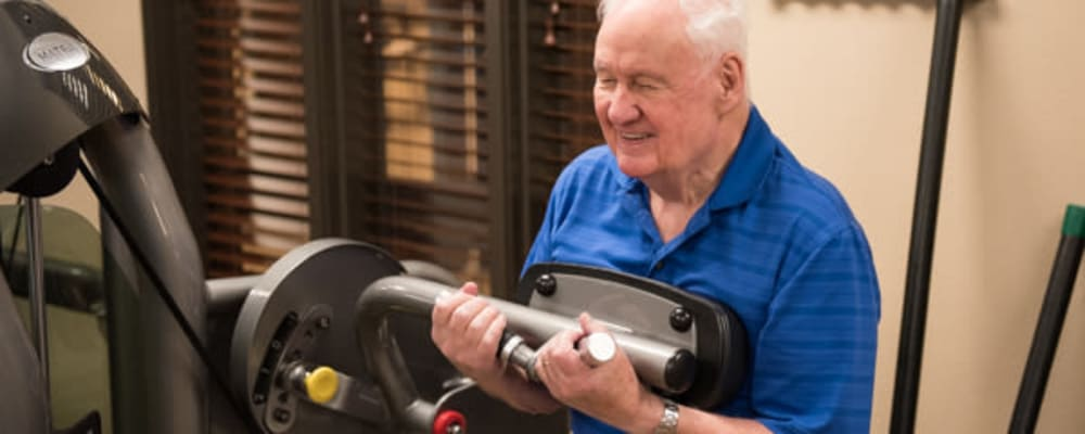 Resident lifting weights in the gym at The Springs at Tanasbourne in Hillsboro, Oregon