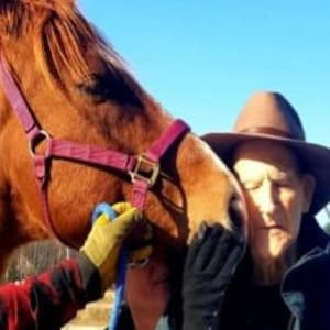Resident James with a horse at his Dare to Dream event at Milestone Senior Living Tomahawk in Tomahawk, Wisconsin.