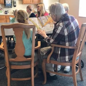 Resident Lois reads to local children for her Dare to Dream event at Lawton Senior Living in Lawton, Iowa