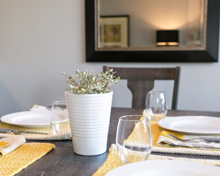 Closeup view of the dining table set in a model home at Sofi Lakeside in Everett, Washington