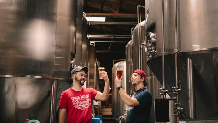 Two brewers enjoy a beer near Olympus Team Ranch in Benbrook, Texas.