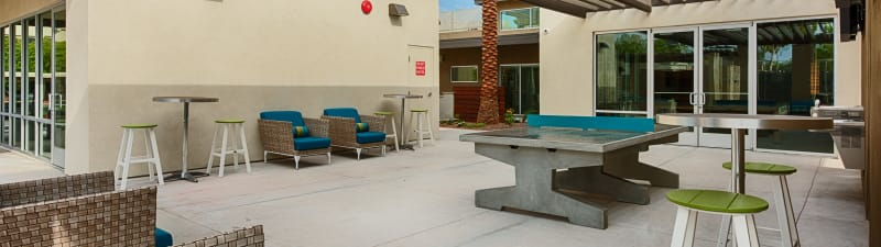 outdoor ping pong at Avia McCormick Ranch Apartments's lobby in Scottsdale, Arizona