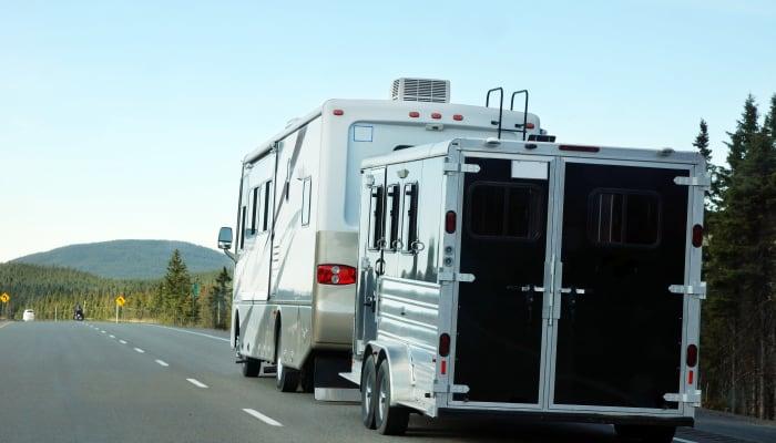 An RV on the road near STOR-N-LOCK Self Storage in Taylorsville, Utah