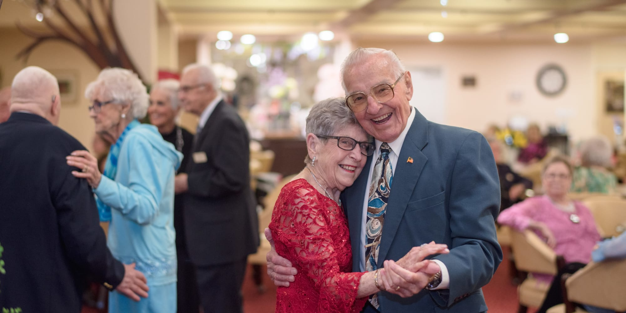 A happy couple dancing at Fairview Estates Gracious Retirement Living in Hopkinton, Massachusetts