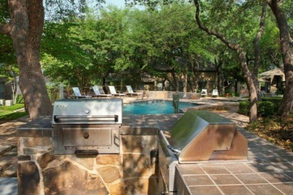 BBQ area with a grill at Carmel at Deerfield in San Antonio, Texas