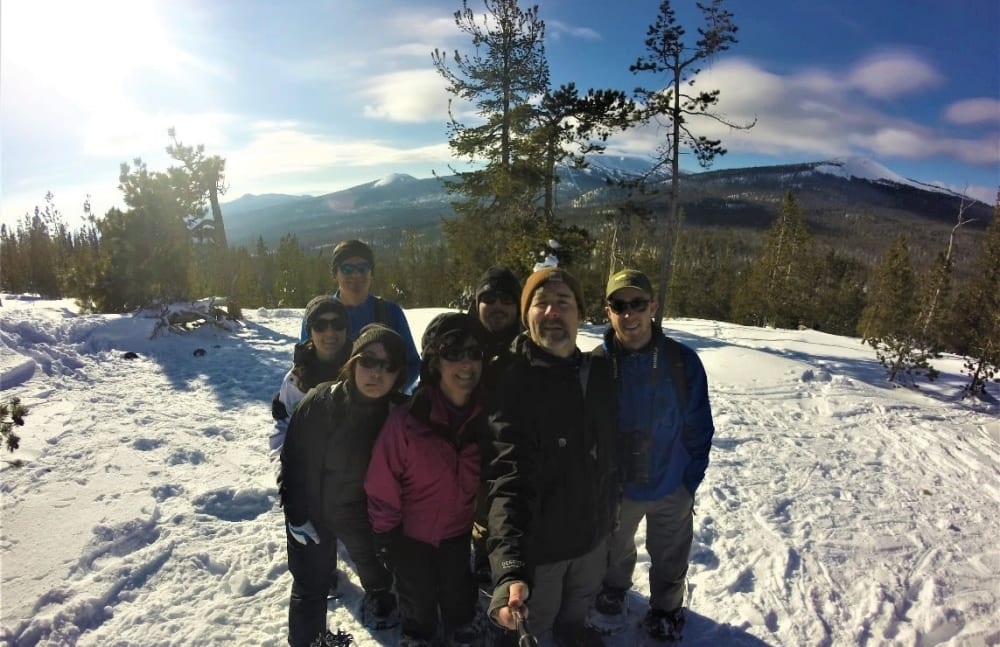Brian E. Pryor from Touchmark Central Office in Beaverton, Oregon and his family on a snowy mountain