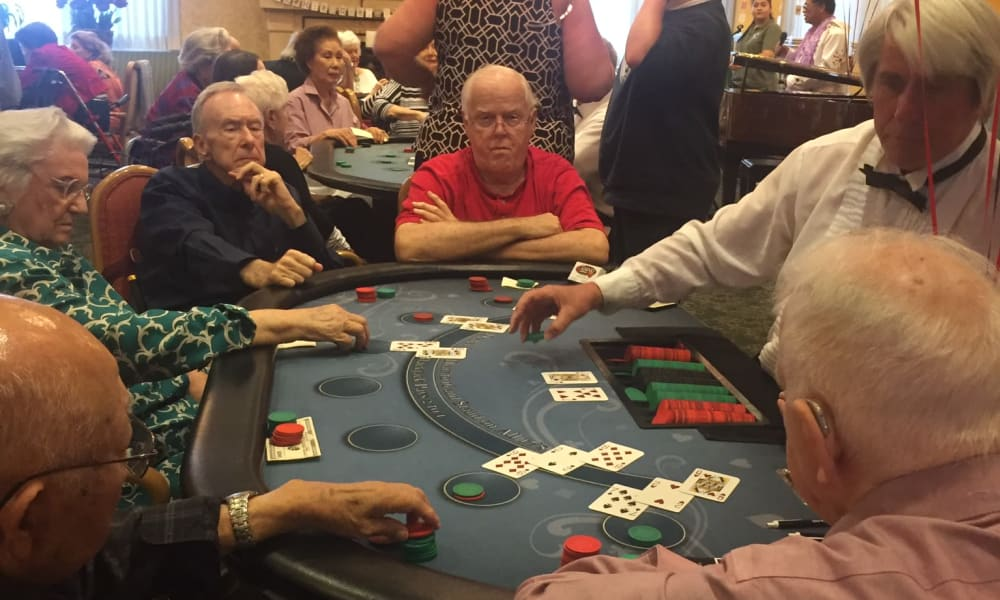 Seniors playing cards at The Fair Oaks in Pasadena, California