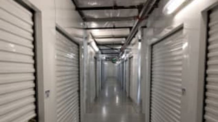 A bright hallway with white storage unit doors at Extra Attic Mini Storage in Richmond, Virginia