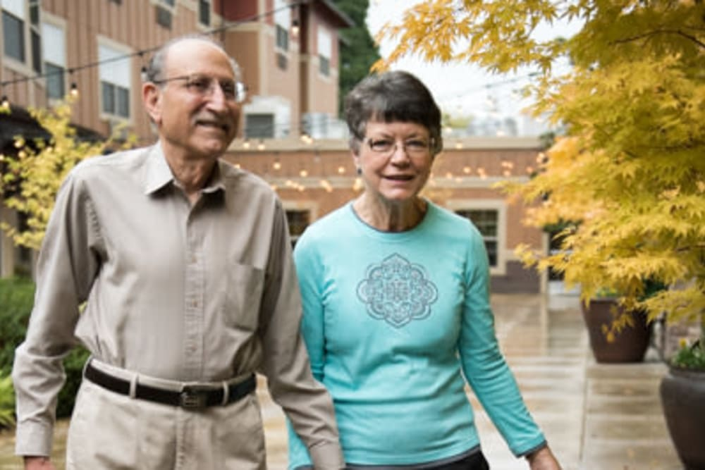 Residents strolling the grounds outside the facility at The Springs at Tanasbourne in Hillsboro, Oregon