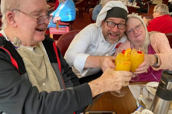 Chef joining residents for a toast at Somerset Assisted Living in Gladstone, Oregon