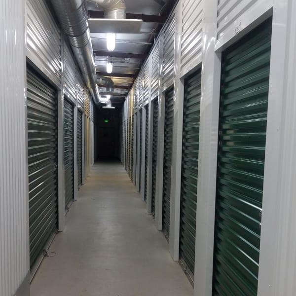 Indoor storage units with green doors at StorQuest Self Storage in Parker, Colorado