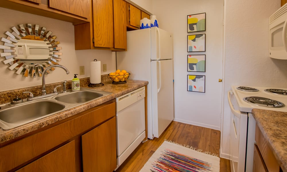 Kitchen with appliances at Windsail Apartments in Tulsa, Oklahoma