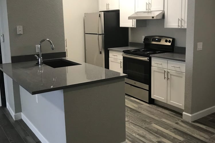 Kitchen layout at Alpine Meadows Apartments in Sandy, Utah