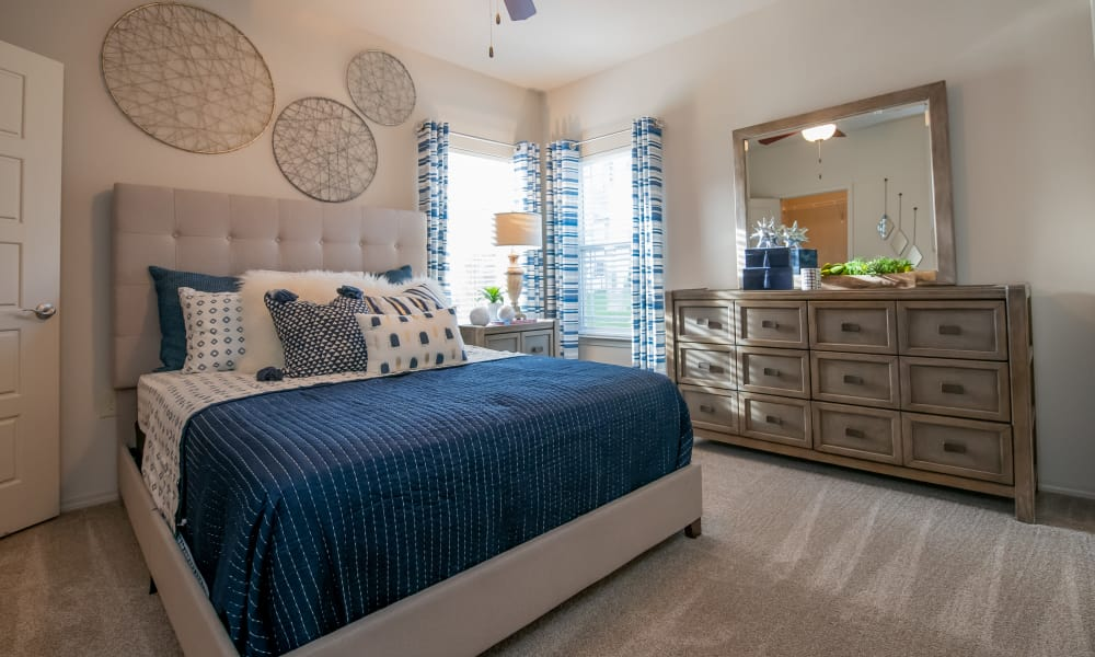 Bedroom with a window at Stonehorse Crossing Apartments in Oklahoma City, Oklahoma