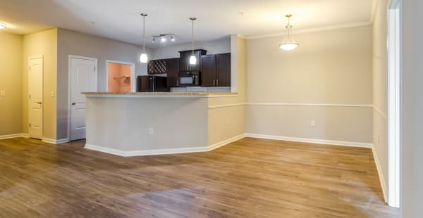 Kitchen with a breakfast overlooking the living room in a model apartment home at Ansley Commons Apartment Homes in Ladson, South Carolina