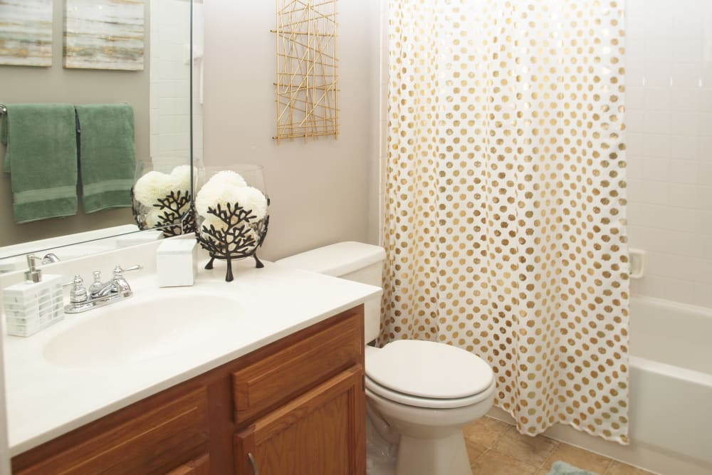 Bathroom featuring a shower and bathtub at Waterford Place in Loveland, Ohio