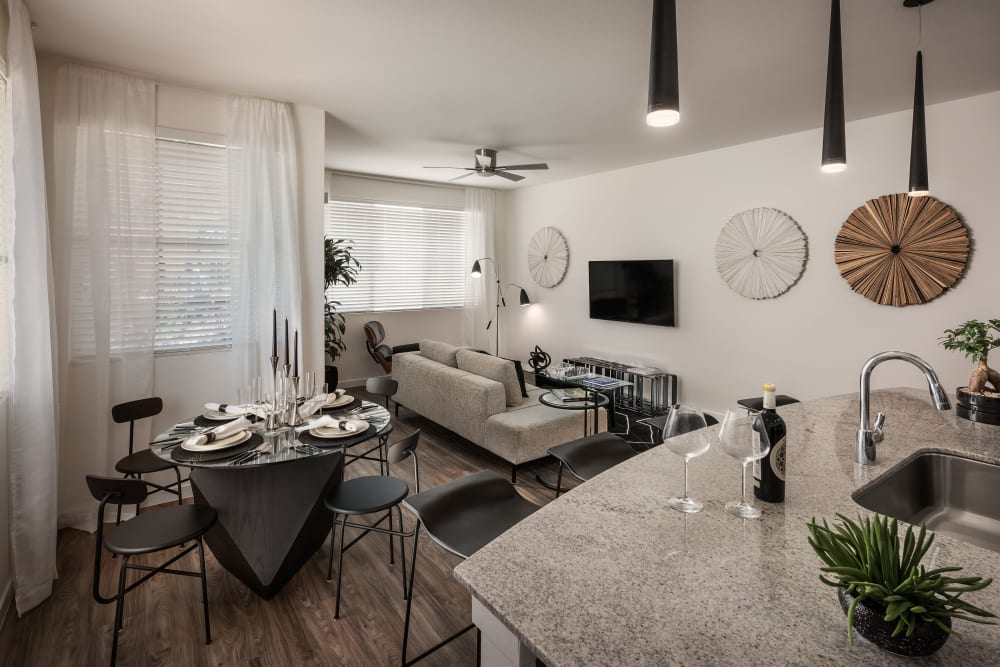 Large living room with ceiling fan and beautiful furnishings in model home at Villa Vita Apartments in Peoria, Arizona