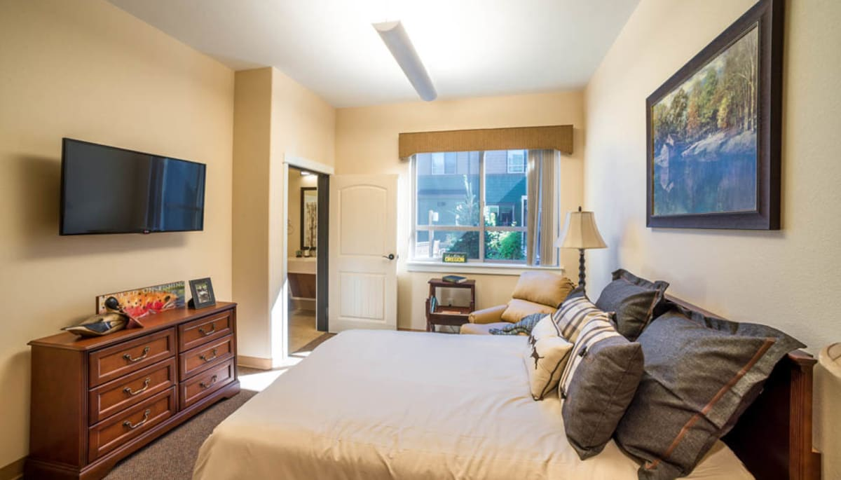 A decorated apartment bedroom at Touchmark at Mount Bachelor Village in Bend, Oregon