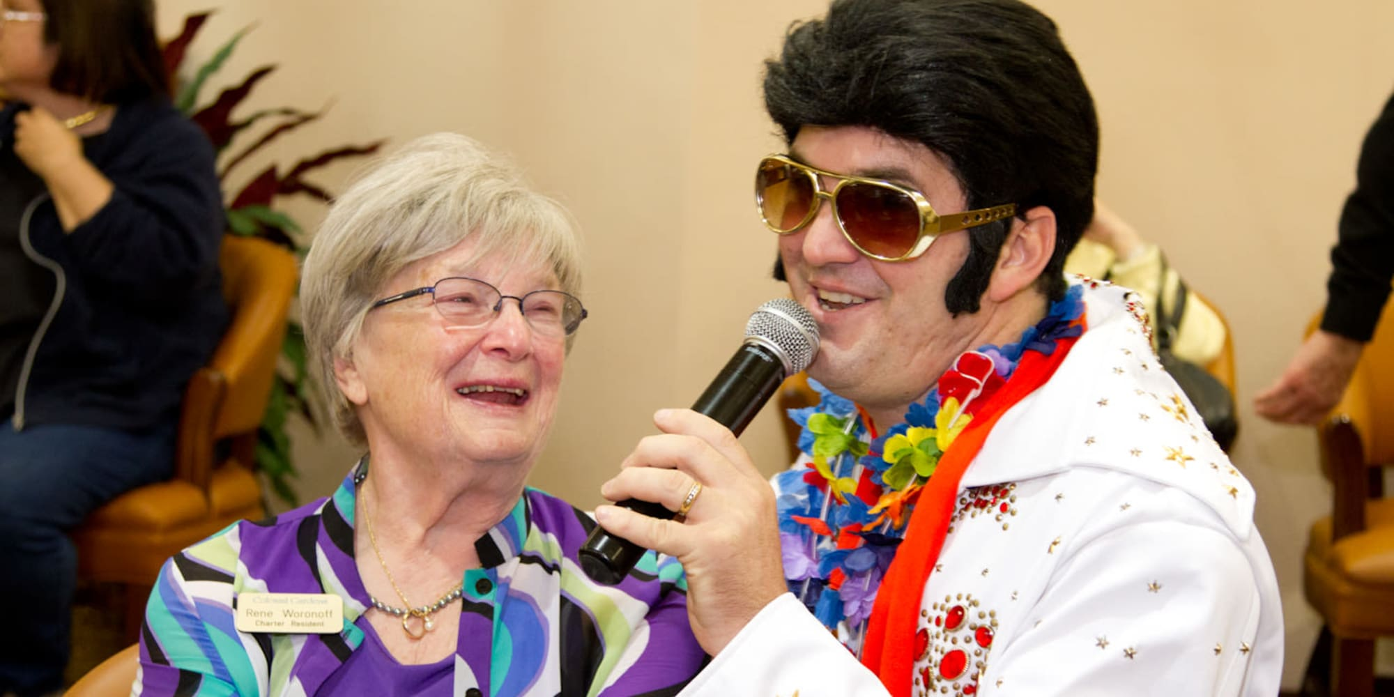 A resident listening to an Elvis impersonator sing at Desert Springs Gracious Retirement Living in Oro Valley, Arizona