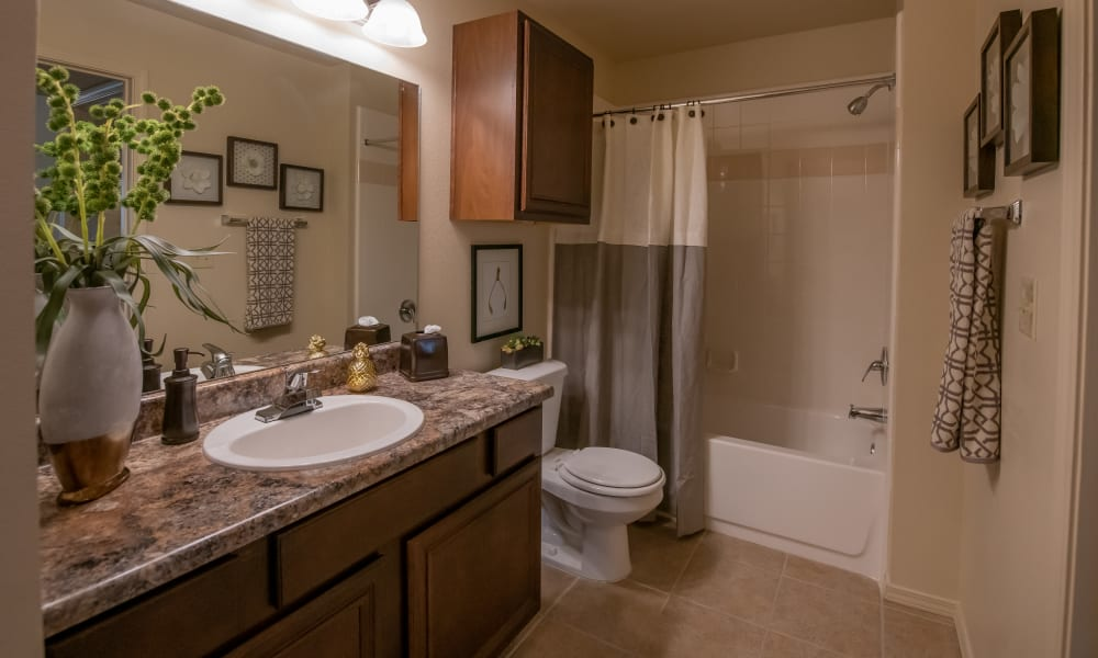 Bathroom with counter space and shower and tub combo at Park at Mission Hills in Broken Arrow, Oklahoma