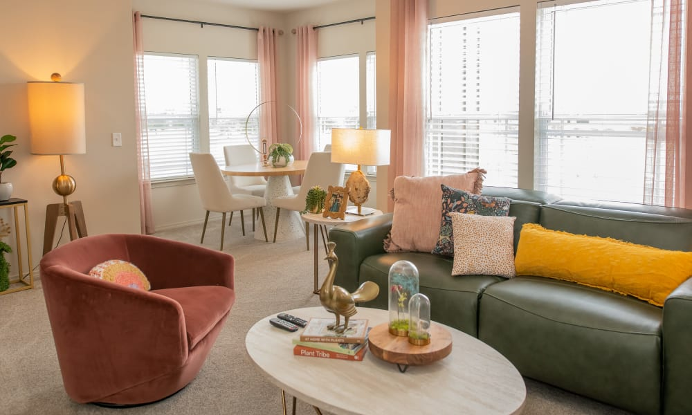 Spacious living room and dining nook at Bend at New Road Apartments in Waco, Texas