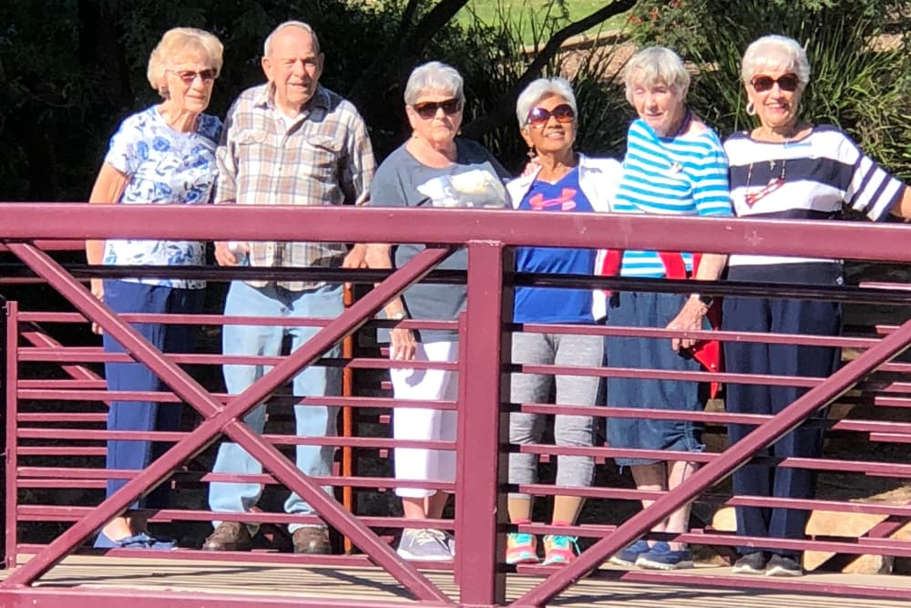 senior residents group photo on a bridge