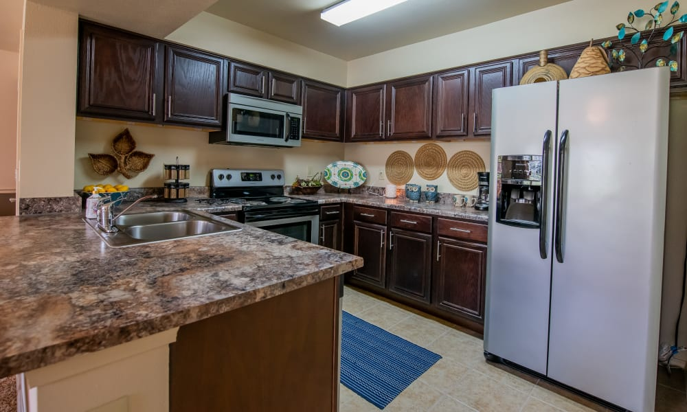 Cozy kitchen with appliances at Park at Tuscany in Oklahoma City, Oklahoma