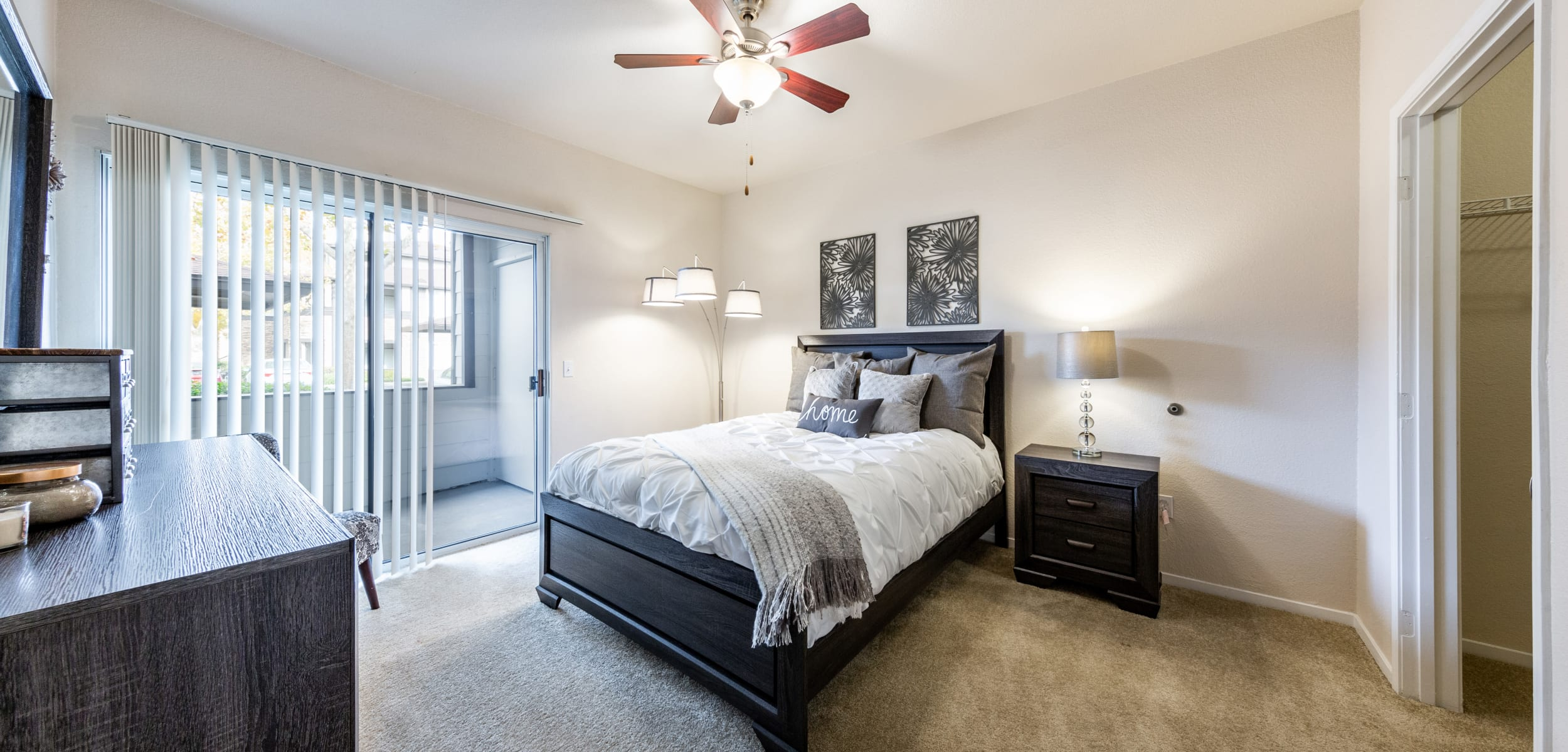Bedroom with a private patio at The Fairmont at Willow Creek in Folsom, California